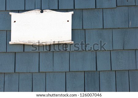 Blank white plaque on tiled wall of New England historic house - stock photo