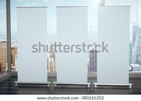 Blank white posters on black wooden floor and glassy walls with megapolis city view, mock up 3D Render - stock photo