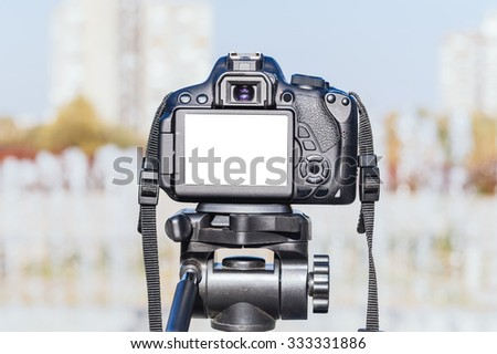 Blank white screen on dslr camera,selective focus - stock photo