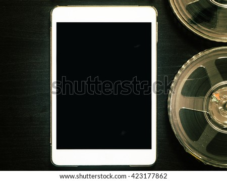 Blank White Tablet with Movie film strip - stock photo