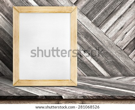 Blank whiteboard wood frame on diagonal wooden table at diagonal wood wall,Template mock up for adding your design and leave space beside frame for adding more text - stock photo