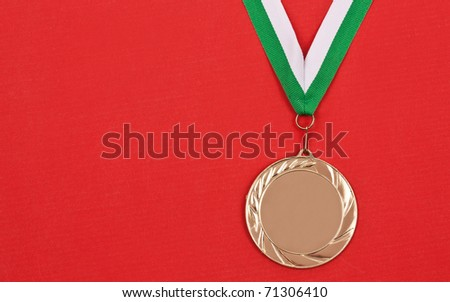 Blank winning medal, in red background