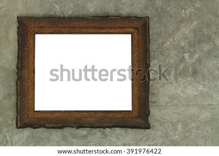 blank wood frame on the cement wall - stock photo