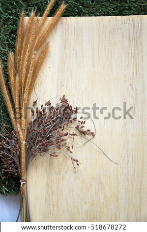 Blank wooden board for text decorate with dried flowers