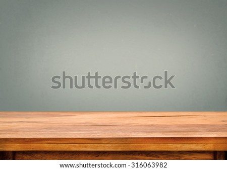 Blank wooden deck table on gray vintage background - selective focus point, shallow depth of field - stock photo