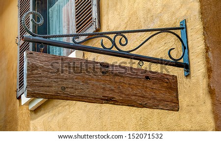 Blank wooden hanging on old wall - stock photo