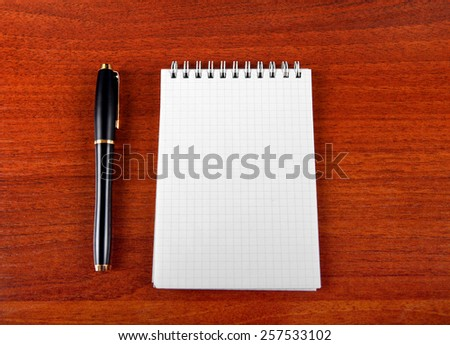 Blank Writing Pad and Pen on The Table - stock photo