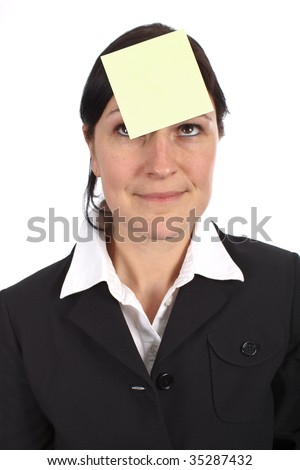Blank yellow adhesive note on womans forehead to remind