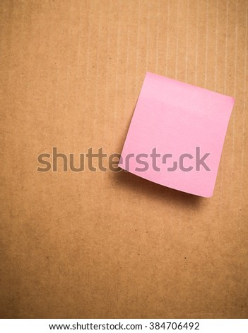 Blank Yellow and pink paper posted on corrugated board - stock photo