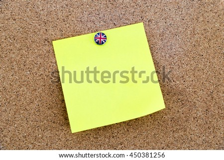 Blank yellow paper note pinned with Great Britain flag thumbtack, copy space available