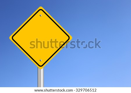 Blank Yellow  Road Sign with clear blue sky background. - stock photo