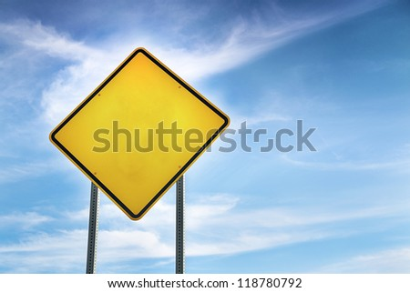 Blank, Yellow Road Warning Sign and blue sky behind - stock photo