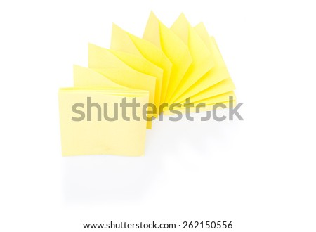 Blank yellow sticky note on block with shadow and reflection on white background - stock photo