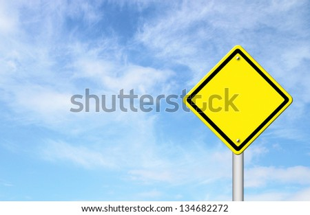 blank yellow traffic sign with blue sky background - stock photo