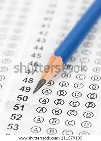 Blanked answer sheet focus on pencil