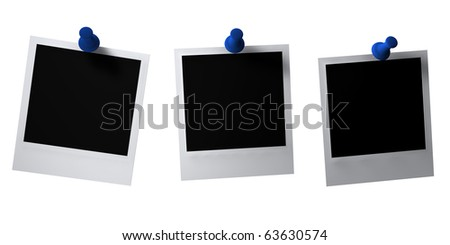 Blanks instant photos with blue thumbtacks - stock photo