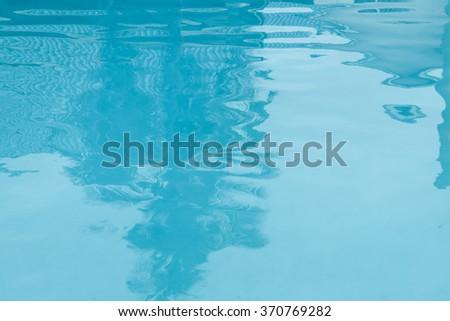 Blasting light over water pool for background design - stock photo