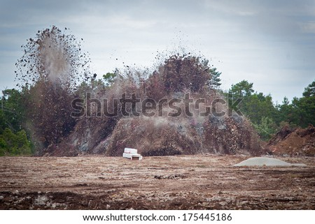 Blasting limestone rock so it can be excavated for the limstone industry.GN - stock photo