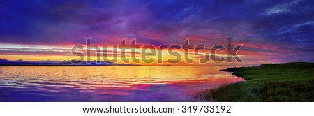 Blasts of colour, created by the sunset, and mountains on the background 2