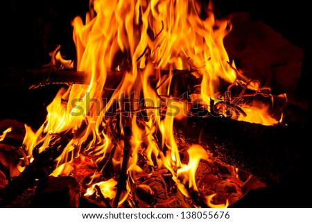 Blazing campfire at campground in the wilderness of the Sierra Nevada, California, USA - stock photo