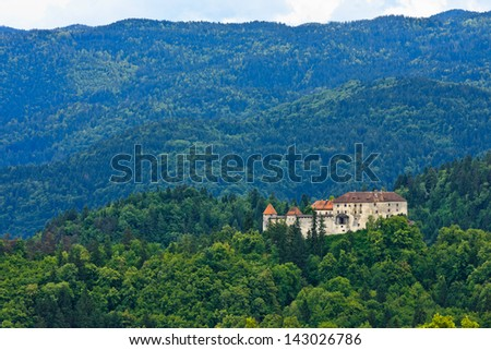 Bled castle surrounded by forest hill top, Slovenia