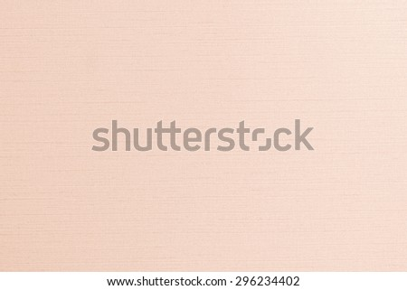 Blended cotton silk fabric textile wallpaper texture pattern background in light orange cream beige pastel color tone   - stock photo