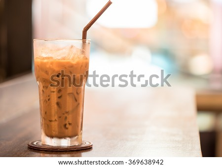 Blended Iced Coffee on table,with vintage color - stock photo