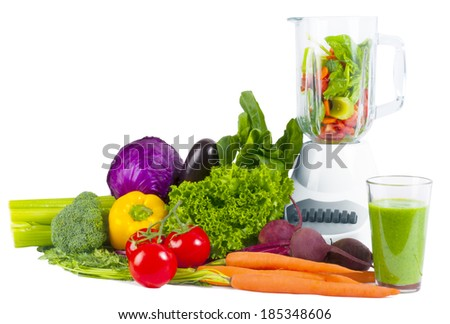 Blender with fresh vegetable  - stock photo