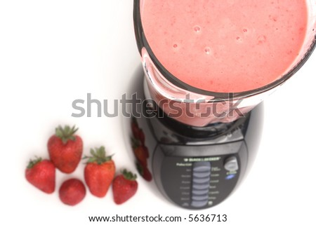 Blender with strawberry cocktail - stock photo