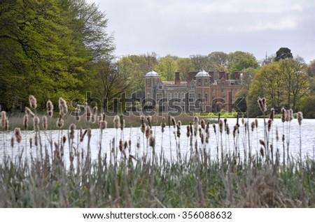 Blickling Hall stately home across the lake on the Blickling Estate in Norfolk, UK. - stock photo
