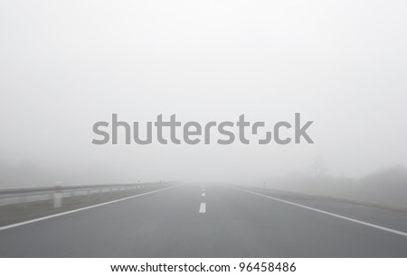 Blind foggy motion ride on highway - stock photo