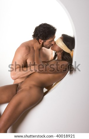 Blind love. Loving nude interracial couple kissing. Mid adult Caucasian men in late 30s and young blindfold mulatto biracial mix of black African American, Native American and German elasticities - stock photo