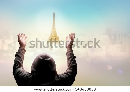 blind man pray over sky with light of hope over middle of Paris city France in pray for Paris concept