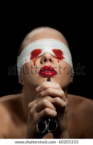 Blind painful woman with blood on face and scissors