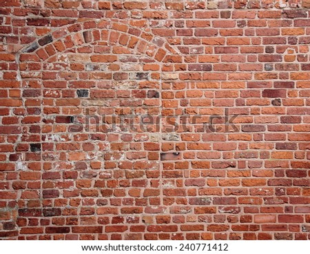 Blind secret hidden entrance in old red brick wall - stock photo