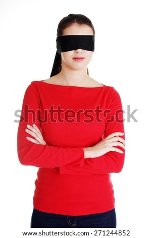 Blindfold woman with band on eyes. - stock photo