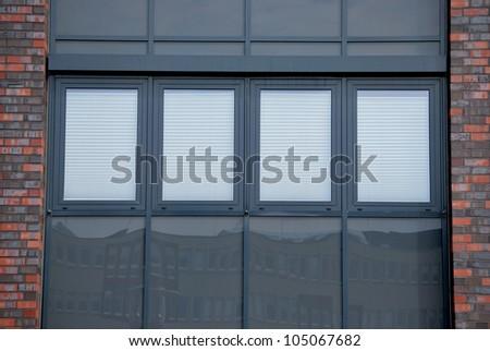 Blinds behind windows - stock photo