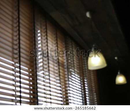 Blinds blur in a home catching the sunlight - stock photo