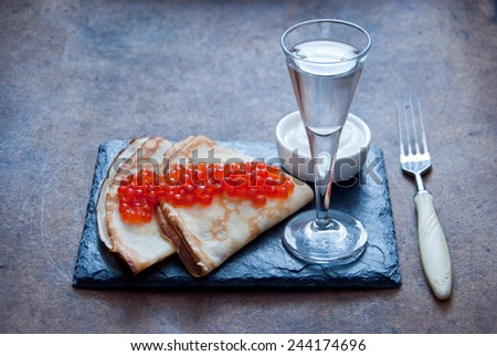 Blini with red caviar  and Vodka - stock photo
