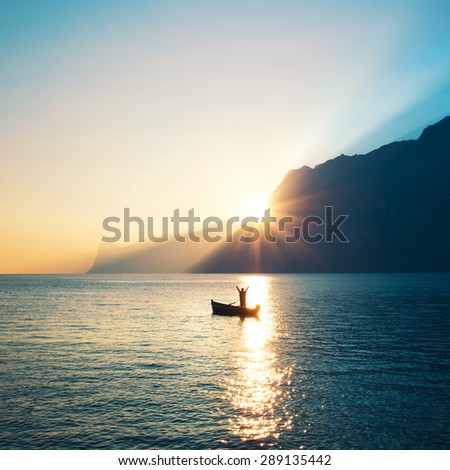 Blissed Man exulted at sunset - stock photo