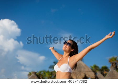Blissful woman at tropical resort caribbean beach enjoying freedom and summer leisure. Summertime vacation tourism and travel concept. Brunette sunbathing and relaxing at Mayan Riviera, Mexico. - stock photo