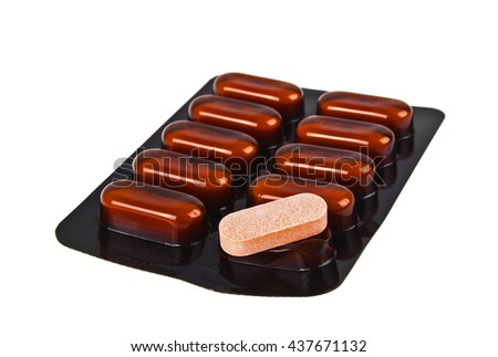 Blister of brown pills on white background - stock photo