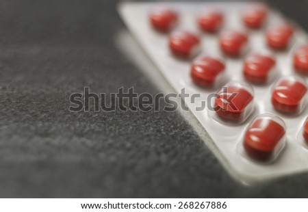 Blister pack of Red medicine pills Close up - stock photo