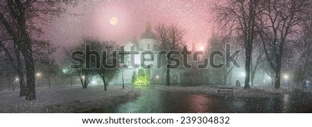Blizzard and rain enveloped Kiev, bad weather a bad review - a romantic mood in the ancient St. Sophia Cathedral, on the background of the ancient walls and trees bashen- monastic park and garden,  - stock photo
