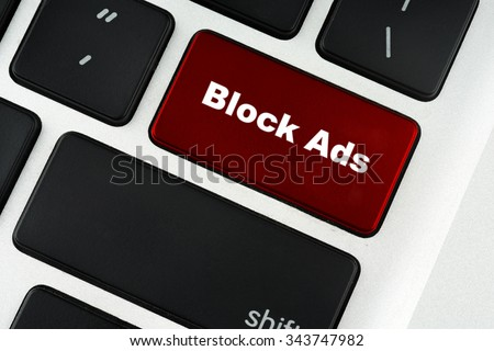Block Ads text on red keyboard button - financial, business, online and data concept - stock photo