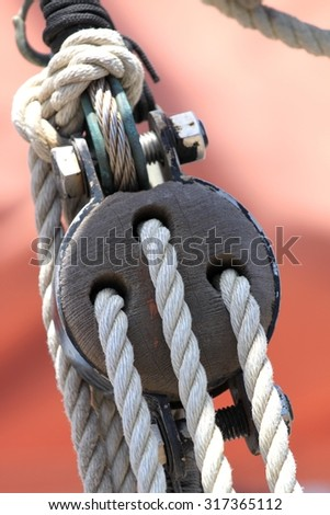 Block and tackle from a sail boat. - stock photo