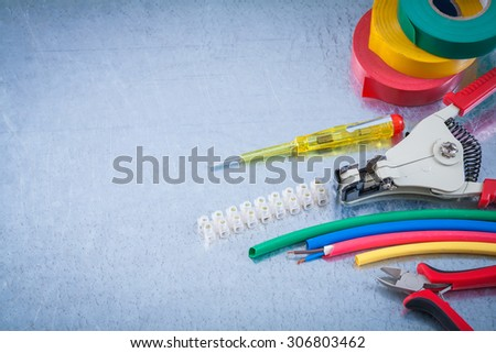 Block clamp nippers strippers insulation tape wire protection insulated screwdriver. - stock photo