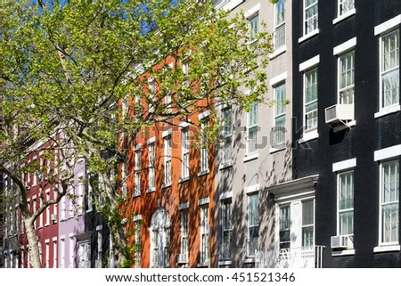 Block of colorful buildings on historic Macdougal Street in Greenwich Village in Manhattan, New York City - stock photo