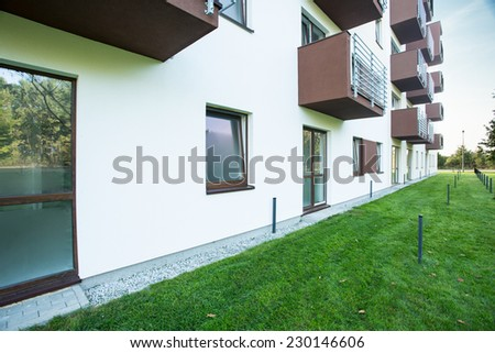 Block of flats with brown painted balconies - stock photo