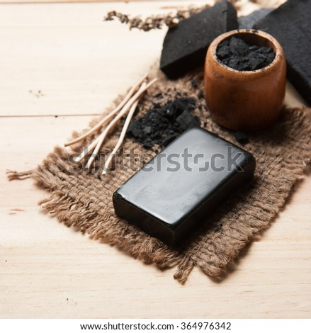 block of natural carbon soap and Black charcoal - stock photo